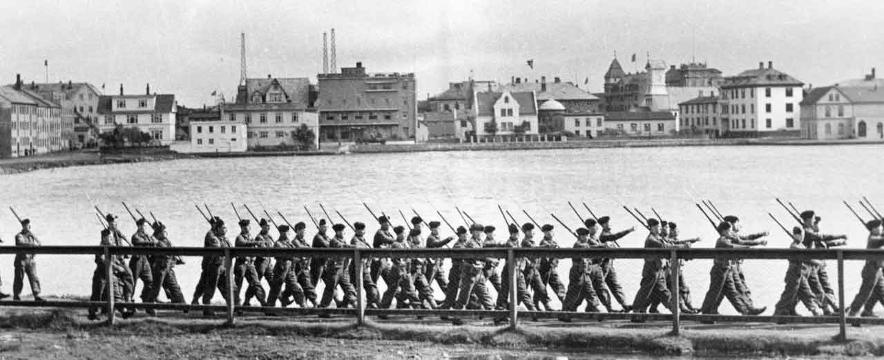 British Occupation forces march across the pond in Reykjavik, 1940